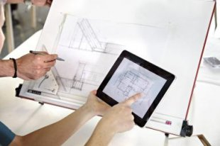 Designer drawing plans from a digital tablet - Photo copyright Oli Kellett / Getty Images