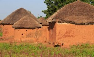 Mud and straw are also used to build huts like this in Ghana,  Africa. Getty Images