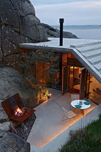 Naturally-Sheltered Summer Cabin Dialogues With The Cliffs