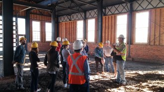 Students learn about the rehabilitation of the Kehoe Iron Works