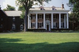 The supporting columns are typical of Greek Revival-style Colonial homes.