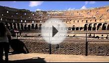 People seen taking pictures of themselves at the Colosseum.